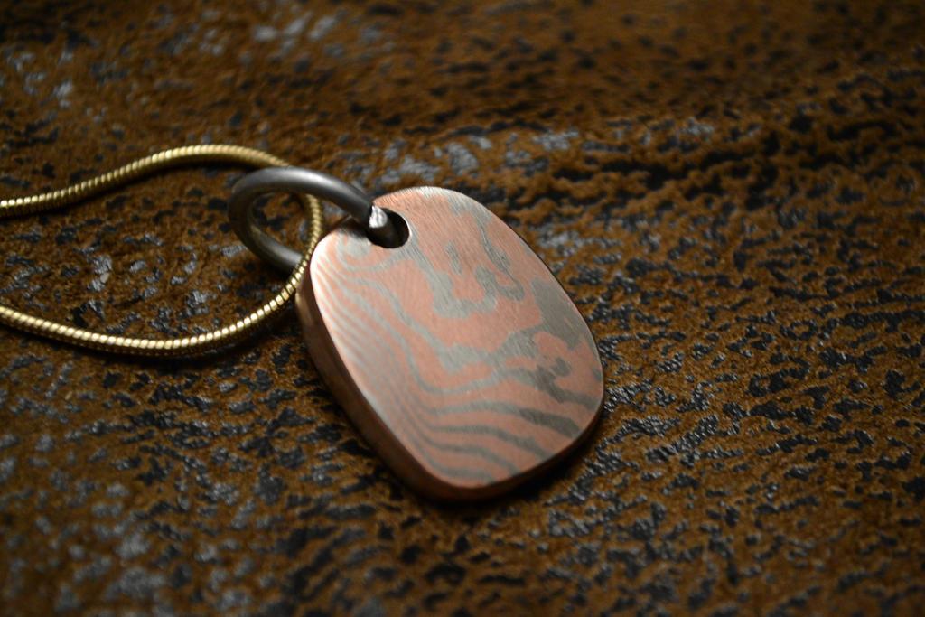 Hammer forger mokume gane pendant by nickwoo2 on deviantart hammer forger mokume gane pendant by nickwoo2 aloadofball Gallery