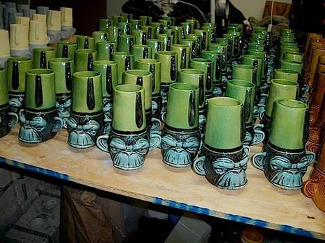 Army of ceramic ape mugs