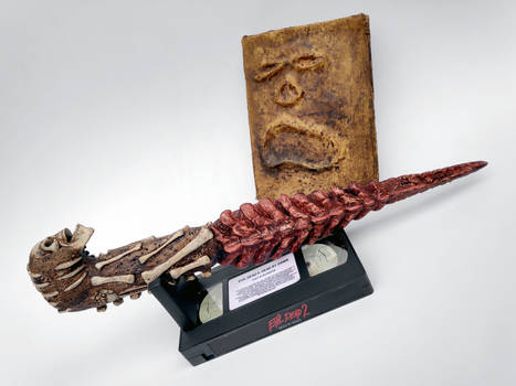 Kandarian dagger and Necronomicon from Evil Dead 2