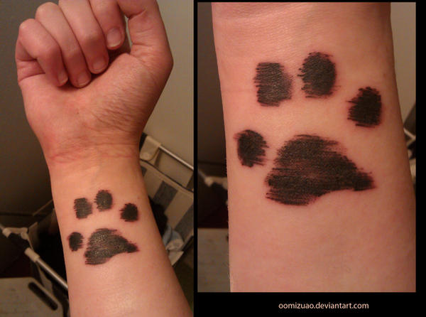 paw print tattoo by oomizuao