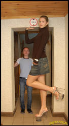 Tall woman short man doorway by lowerrider
