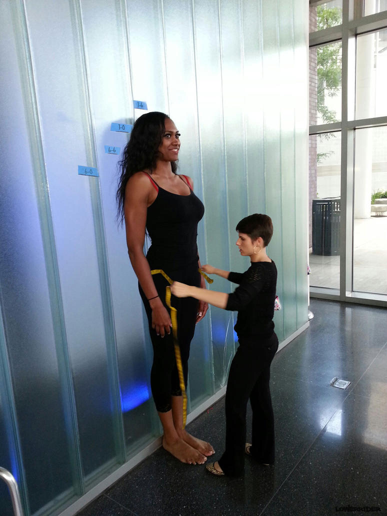 Tall model being measured by lowerrider
