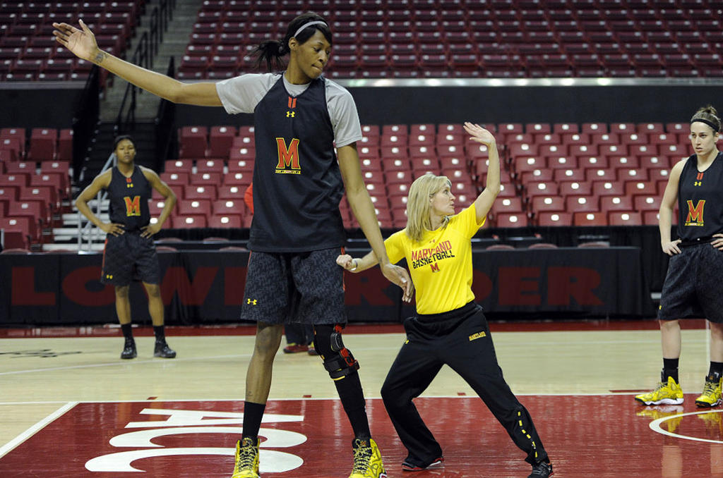 Tall basketball player and tiny coach by lowerrider