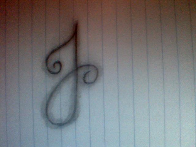 Tattoo letter j