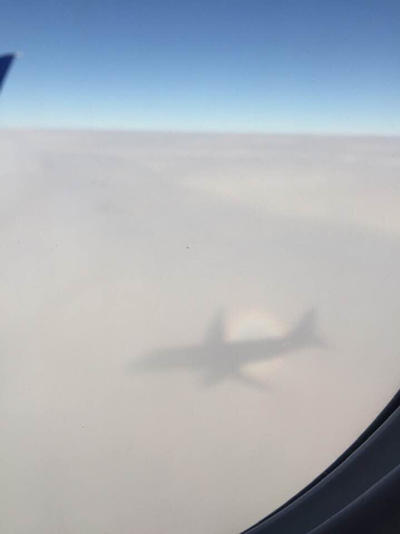 Shadow surfing the clouds by gentleEvan