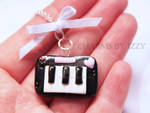 Cute detailed keyboard charm necklace with a bow