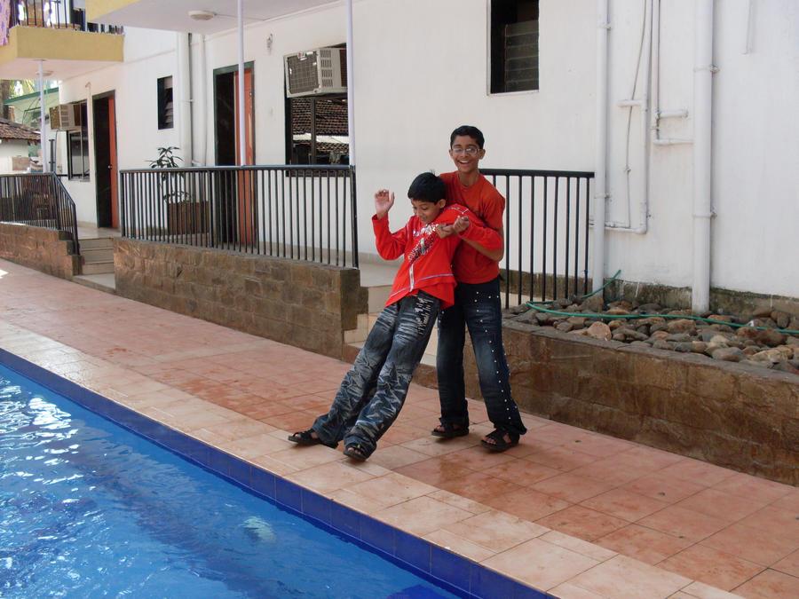 playing at swimming pool by Laxmi-Arts