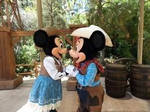 Cowboy Mickey and Cowgirl Minnie kissing
