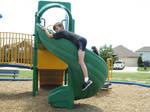 Boy Straddling Slide