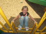 8 Year Old Girl Playing At Park