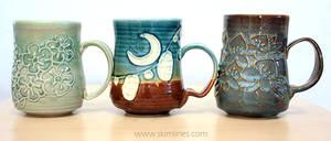 Blossoms, lanterns, blue iris mug by skimlines