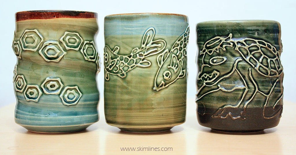 Turtle shell motif, fishes, dark green Kappa by skimlines