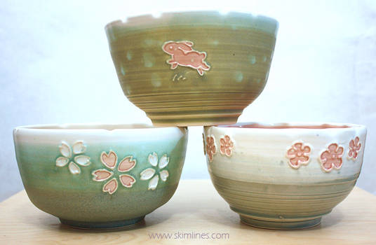 Bowls with flowers and one rabbit