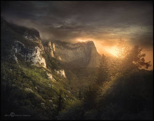 Sunset between mountains by Vittorio-Pellazza