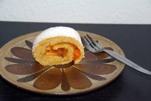Homemade sponge cake with pumpkin jam