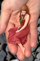 Tiny Kahina Spirit enjoys a rose and a handy lift by Cariwebo