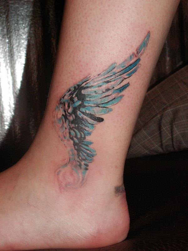 Фото тату крылья маленькие