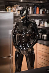 Prisoner of a latex symbiote  by Stevencdaniels