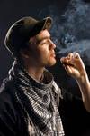 STOCK cuban man smokes