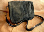Black elegant messenger bag with delicate fur