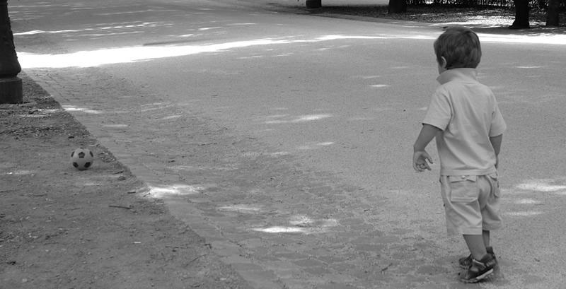 Boy playing ball by Alredhead