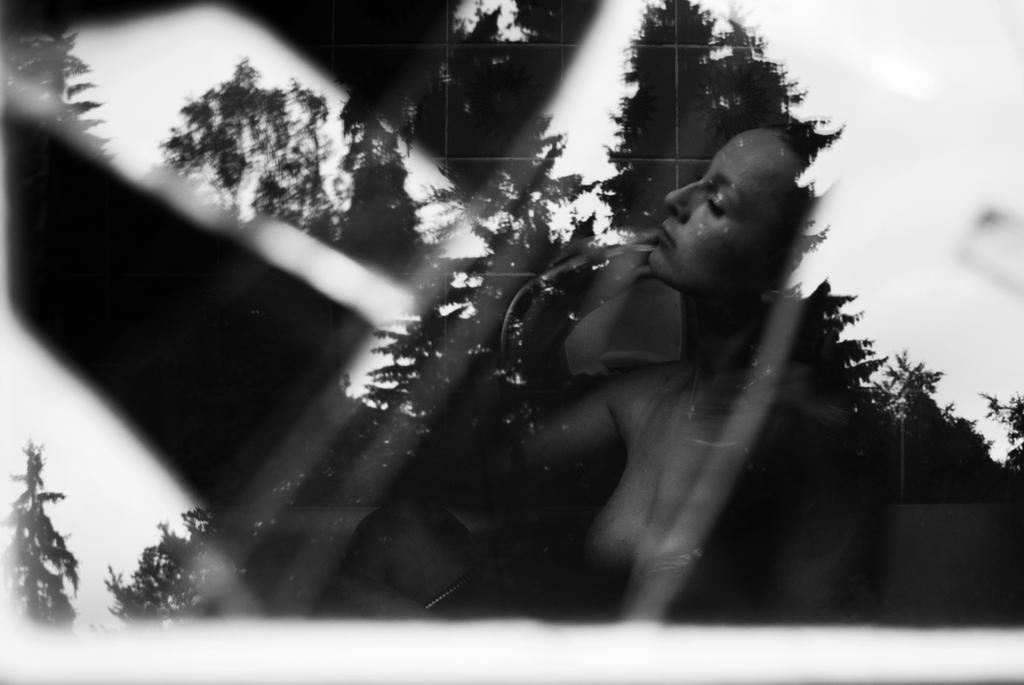 Behind the window by Lucienel