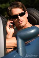 Suave Guy on the Blackberry by JBoettner