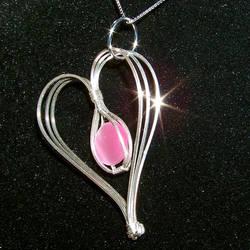Pink Cat's Eye Heart Pendant by innerdiameter