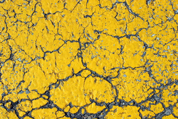 Cracked Yellow Asphalt
