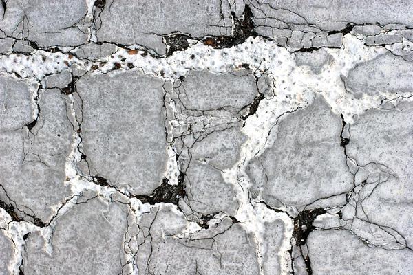 Damaged Asphalt Surface by GrungeTextures
