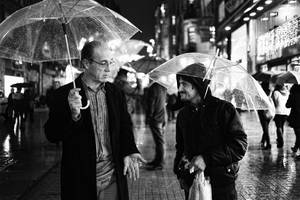 two umbrella men by celilsezer