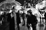 two umbrella men