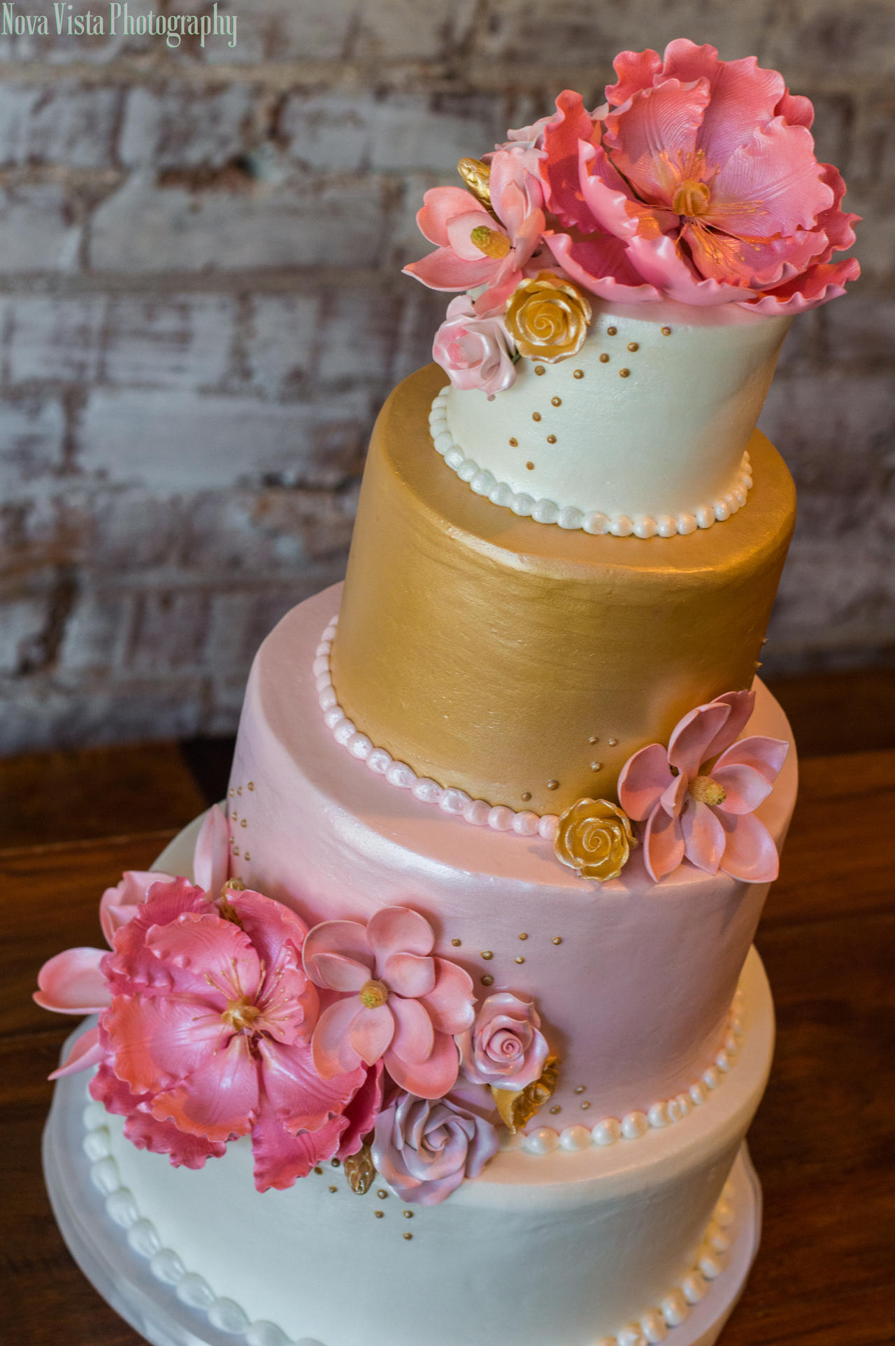 Pink and Gold Four Tiered Wedding Cake by