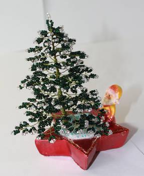 Santa Claus under a fir tree