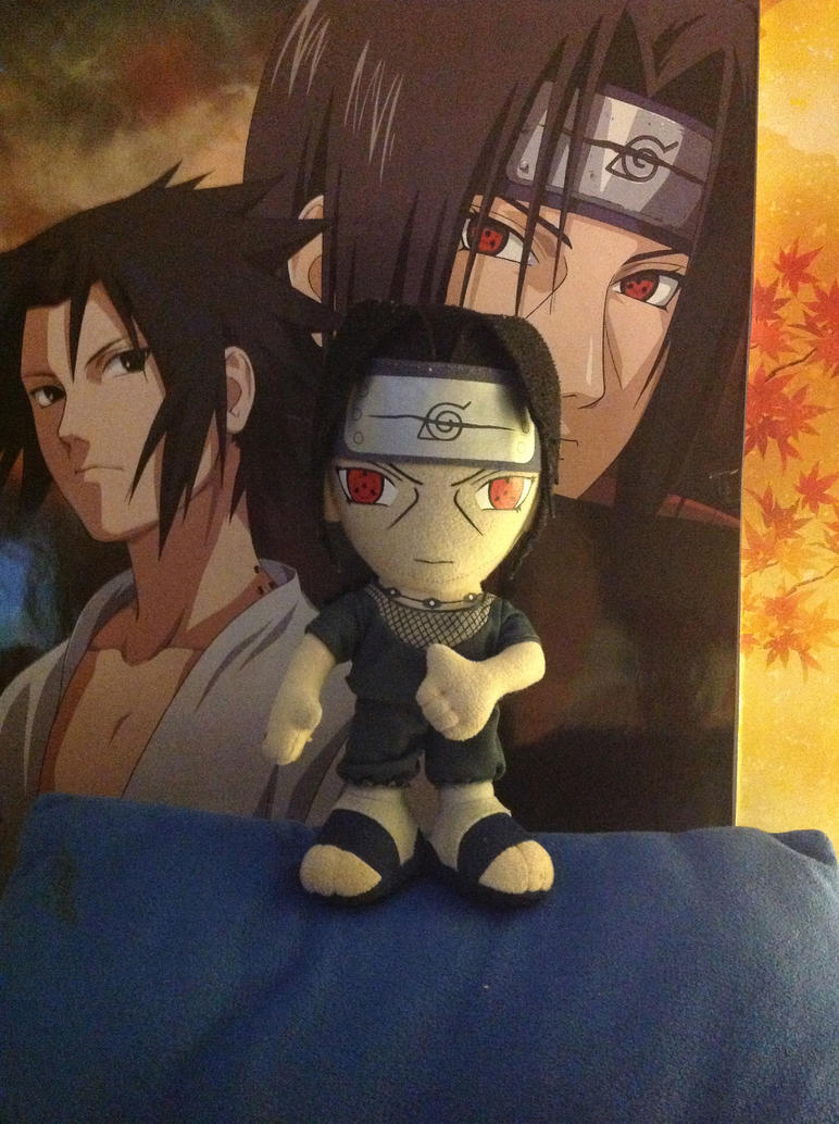 Itachi posing in front of poster. by Ryani