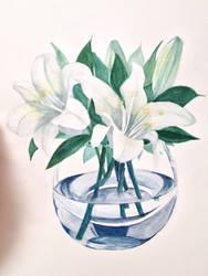 White lily in glass vase