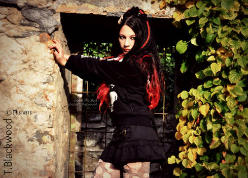 modern goth girl with red and black hair