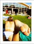 .lying in the sun