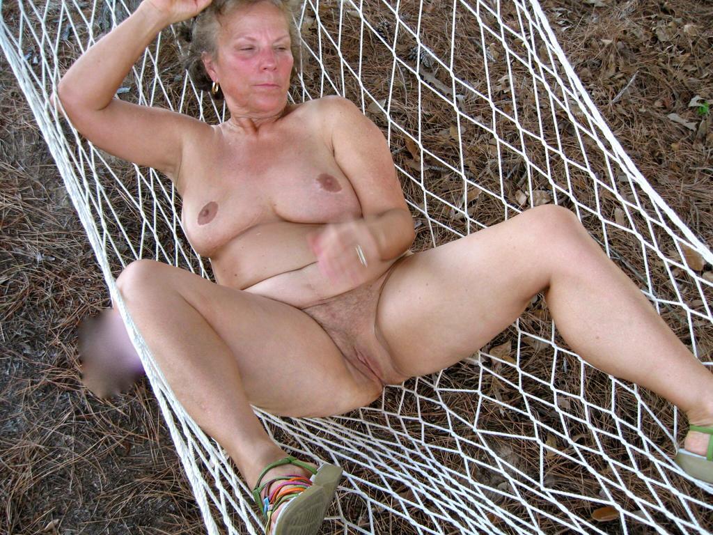 Mature nude female exposed in hammock by Seemoramee