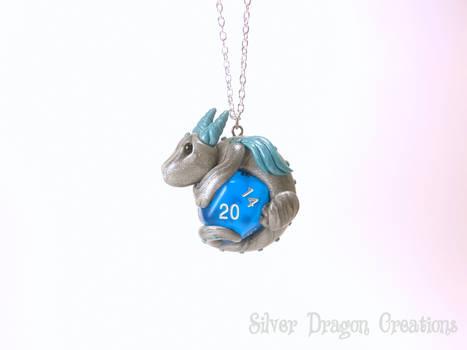 Silver Dragon on Blue Translucent d20 Die