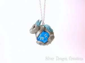 Silver Dragon on Blue Translucent d20 Die