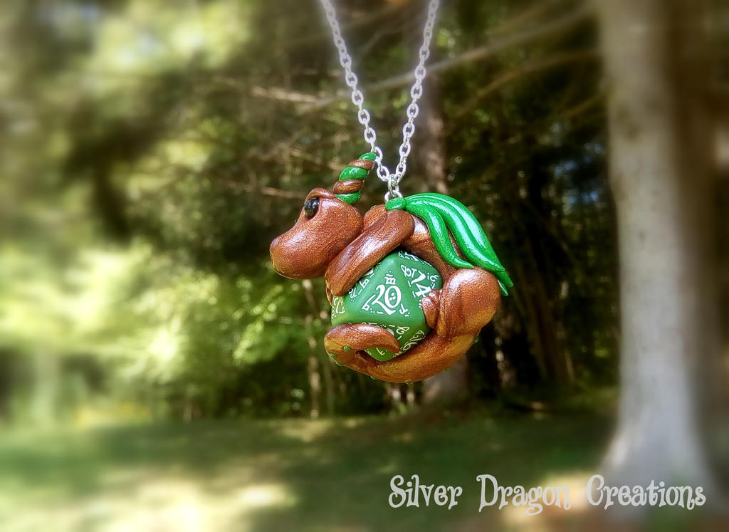 Brown Dragon on Green Elven d20 Die by Euphyley