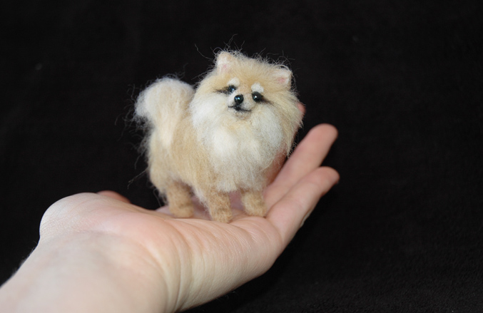 tiny pomeranian puppy needle felted by amber rose creations