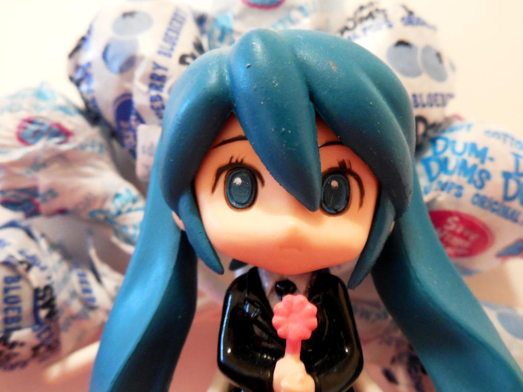 Miku and lollipops by evangeline40003
