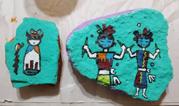 Painting Hopi on rocks