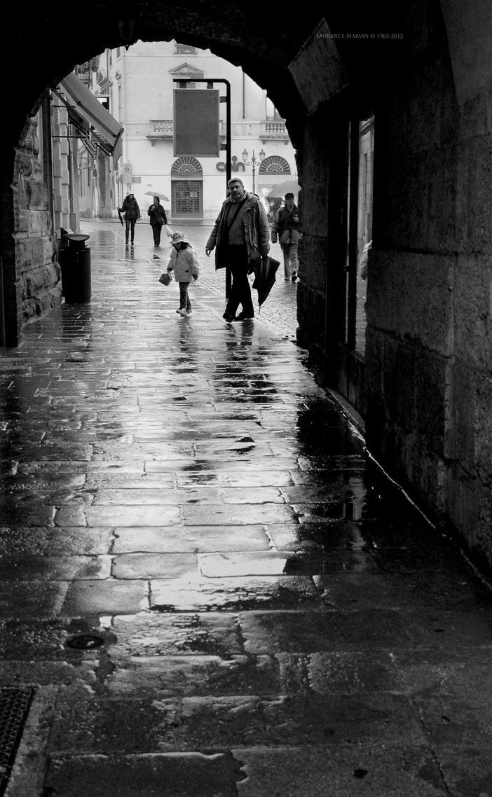 Rain Walkers...Vicenza Italy by PzlWksMedia
