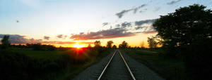 Panoramic June Sunset Over the Railroad Tracks by DaLeahWeathers