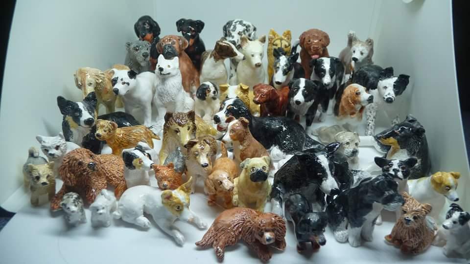 Ceramic dog sculptures by DogDust