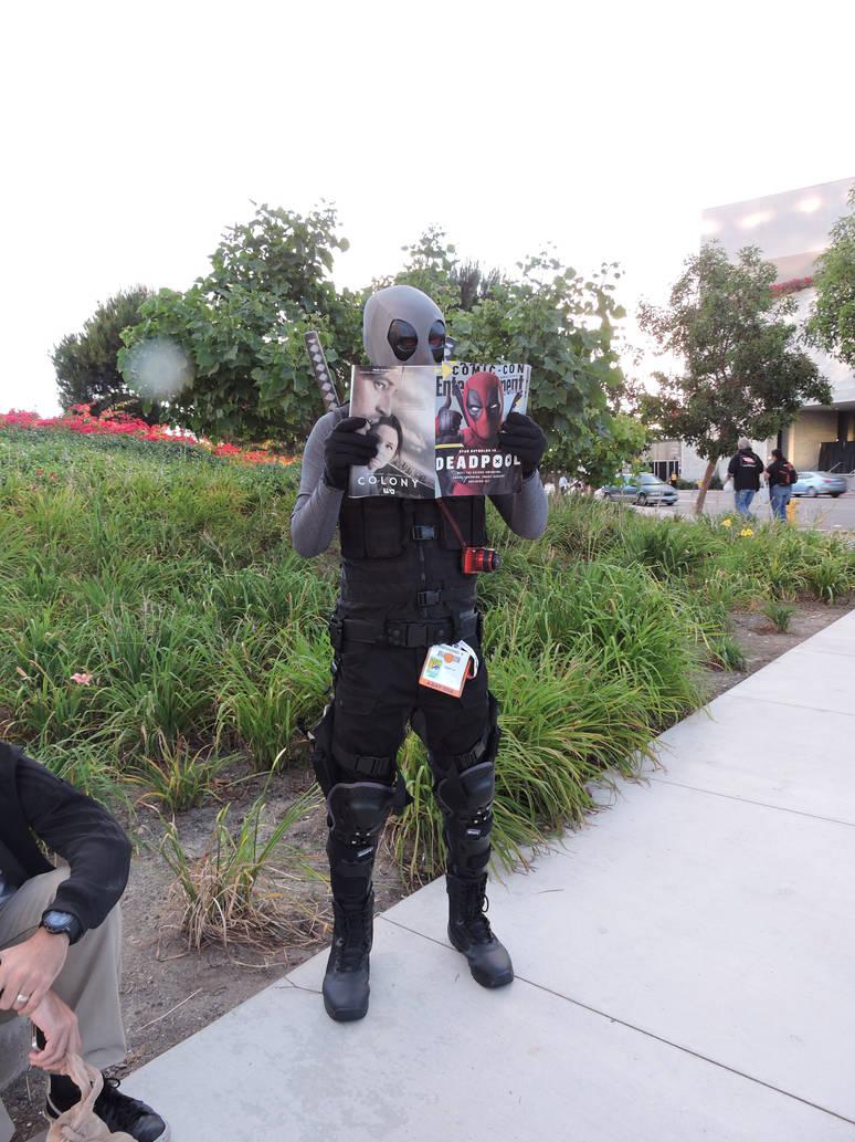 Deadpool reading his favorite subject by IreneAdler76