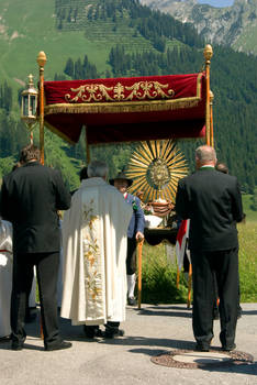 Priest with Blessed Sacrament